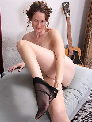 Hot MILF Undressing Porn Pictures
